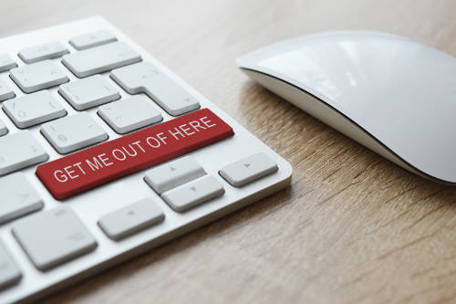 A photo of a keyboard with a button saying 'get me out of here' linking to the page section about scams