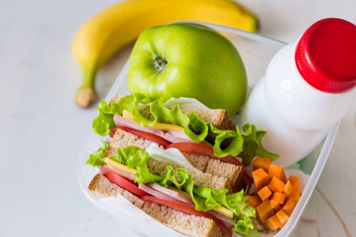 A photo of a healthy lunch linking to the page section about staying healthy