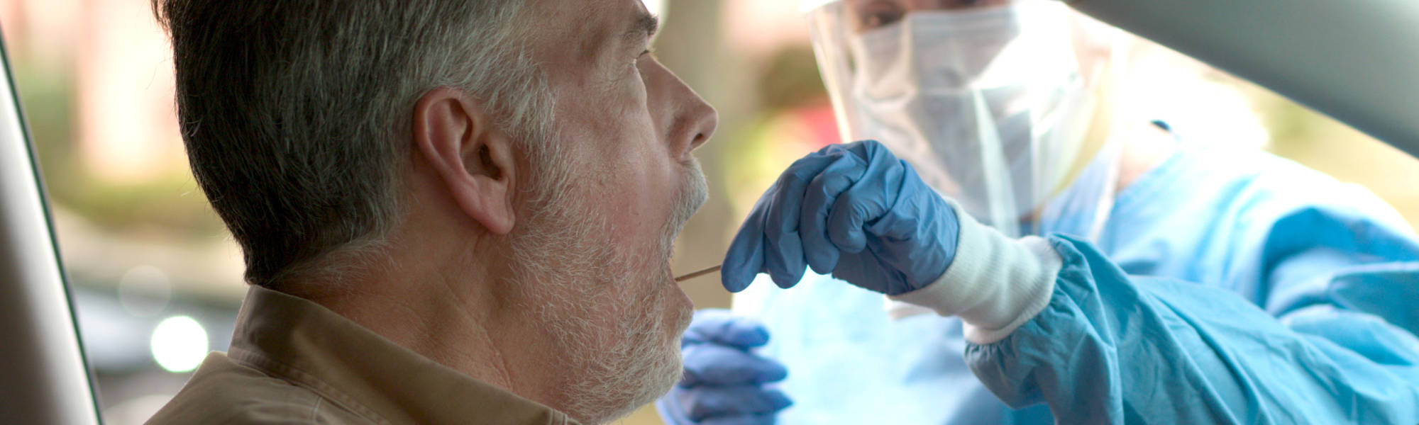 Photo of a man getting tested for coronavirus linking to the page section about how to get tested for coronavirus