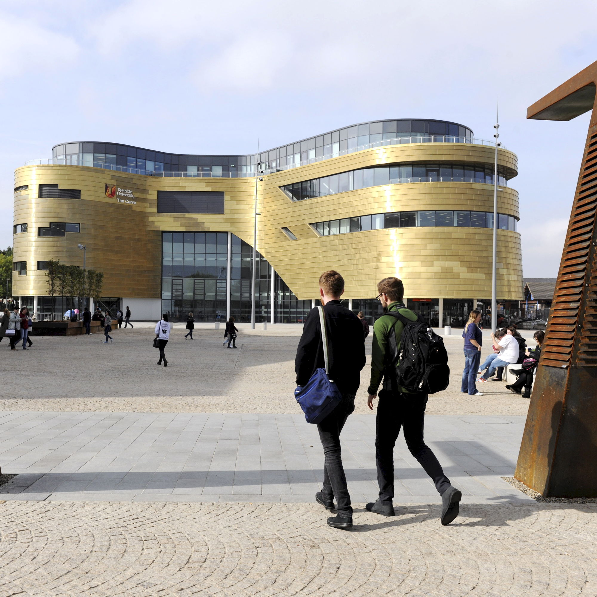 A photo of people at university which links to a page about high quality education