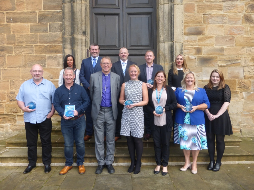 Winners of the Nepacs awards 2017 with Bishop Paul, who presented the awards at Lumley Castle
