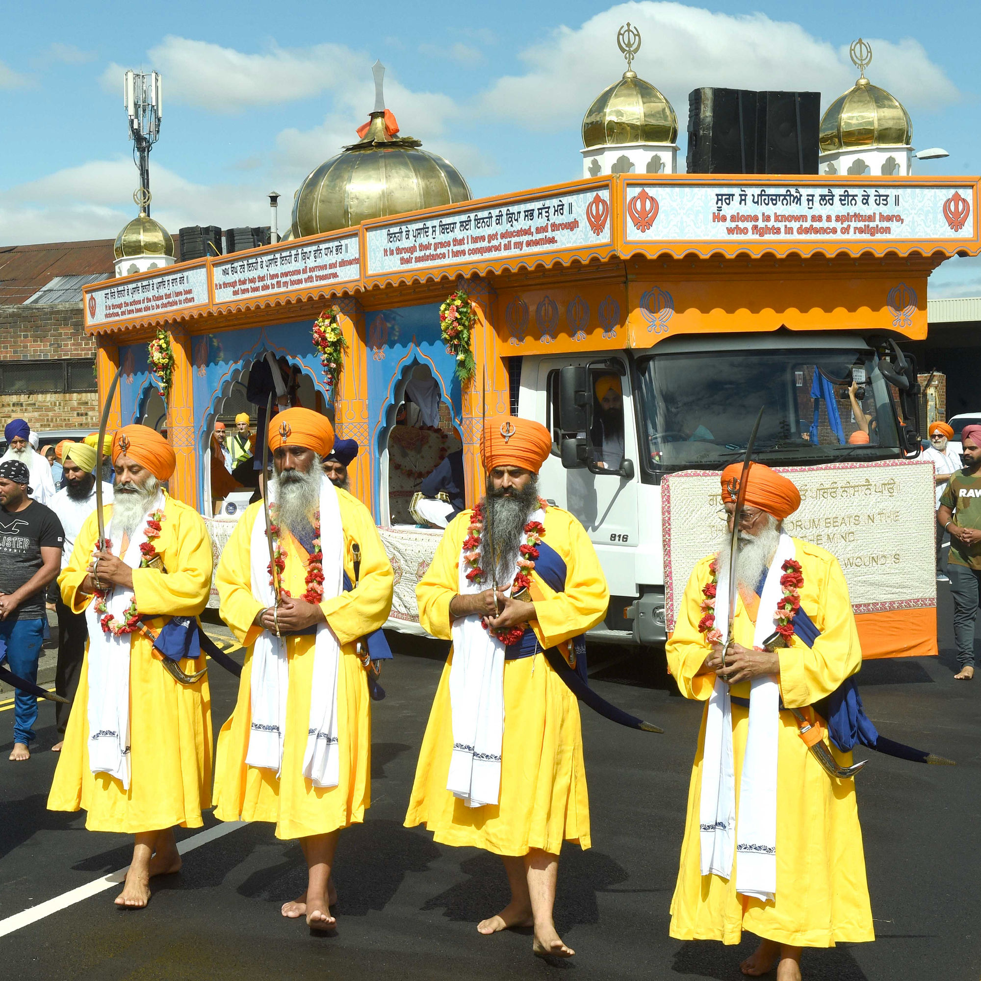 A photo of the Nagar Kirtan parade which links to a page about strong communities