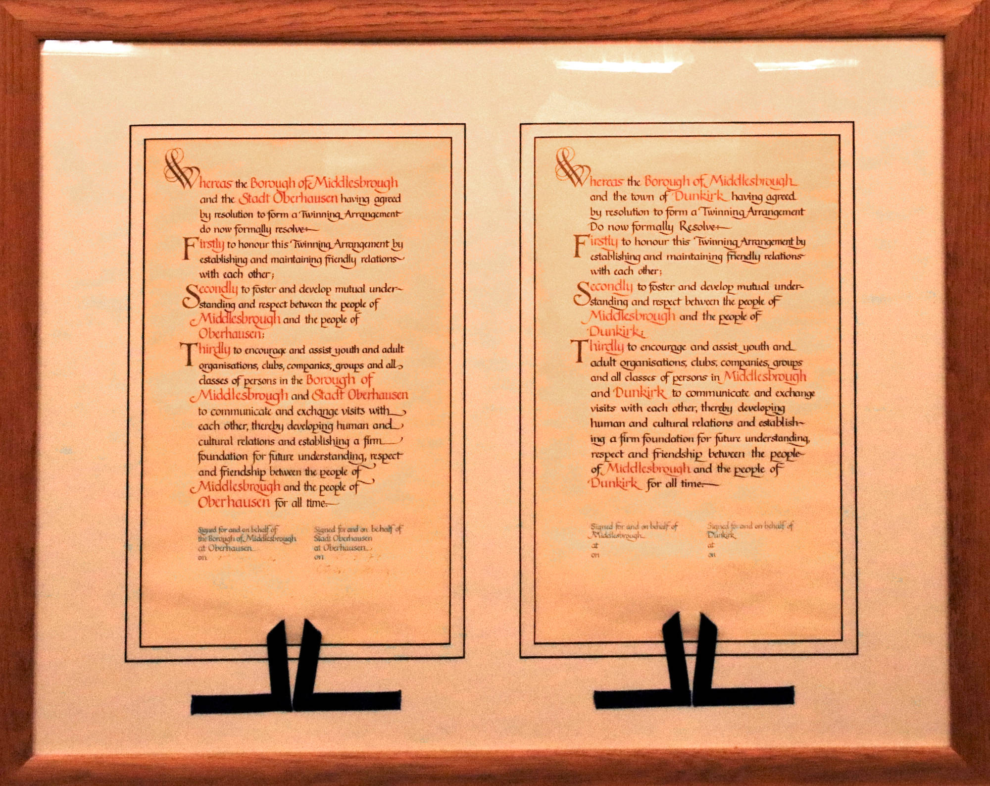 A photo of the town twinning agreements with Oberhausen and Dunkirk in English