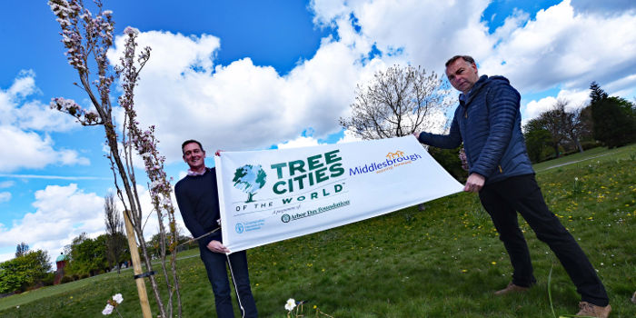 A photo of people holding a banner saying Tree City of the World linking to the page about Middlesbrough being named a Tree City of the World