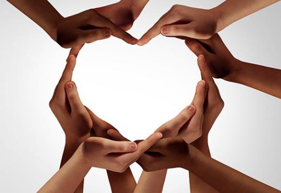 a group of hands making a heart shape