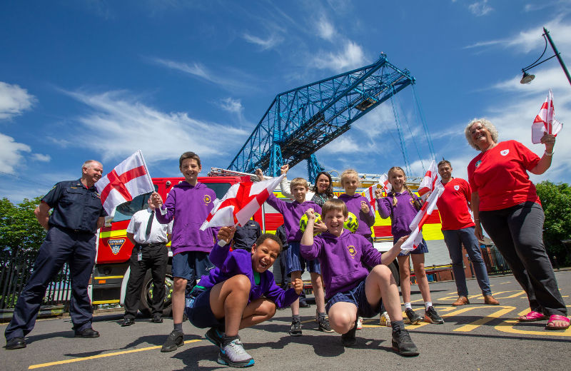 A photo of representatives from Cleveland Fire Brigade, Middlesbrough FC, and Middlesbrough Council, and pupils from St Bernadette's Primary School in Middlesbrough