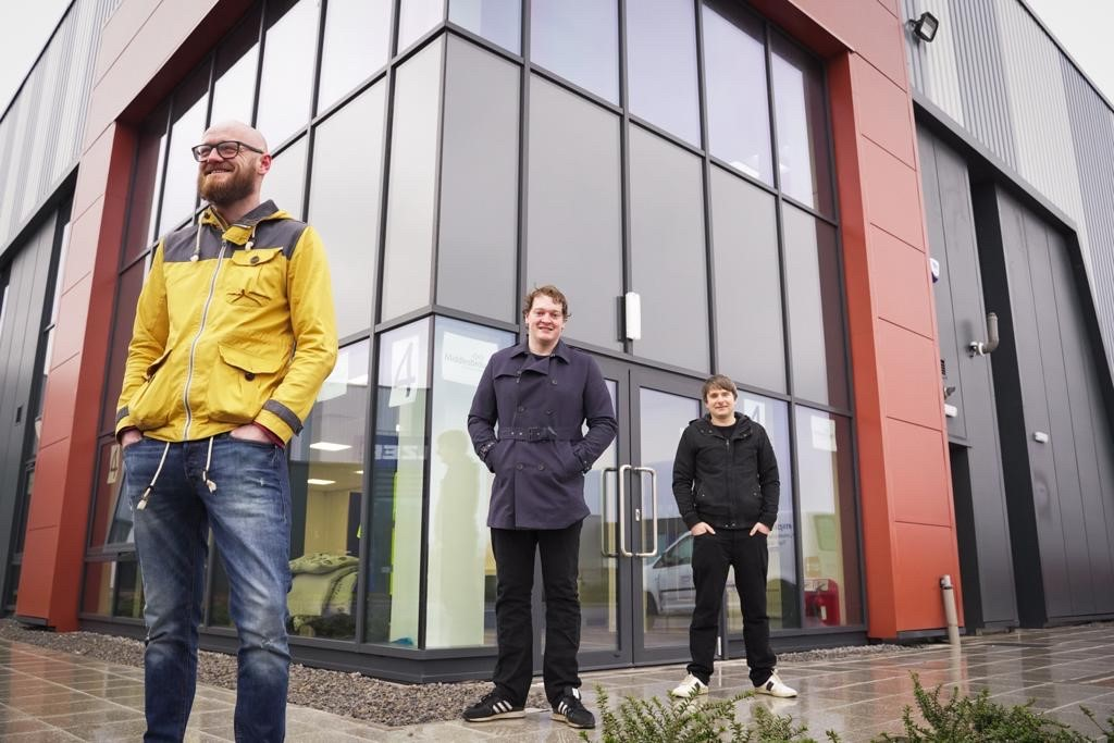 A photo of Press On Vinyl company directors Danny Lowe, David Hynes, and David Todd outside the company's unit at TeesAMP