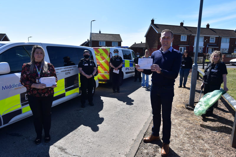 A photo of Middlesbrough Mayor Andy Preston with officers from the Neighbourhood Safety team, Cleveland Police and Thirteen Housing