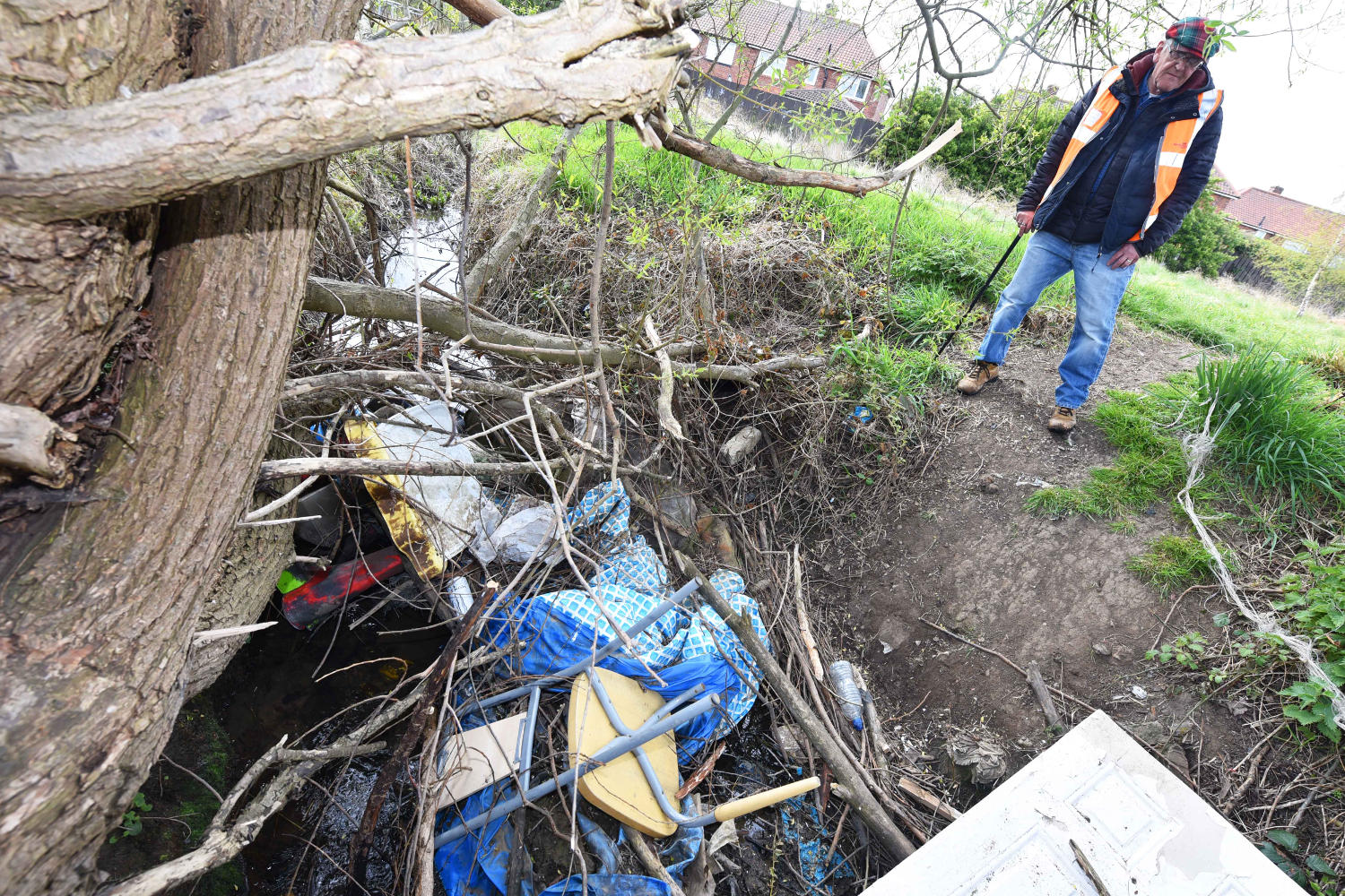Councillor Graham Wilson with examples of widespread fly-tipping along Spencerbeck Beck and around Thorntree Park
