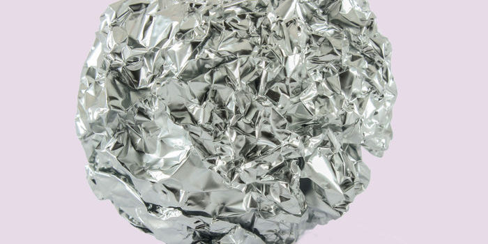 A photo of tin foil linking to the page section about recycling tin foil