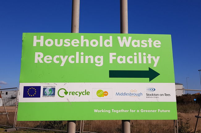 A photo of the Household Waste Recycling Centre sign linking to a page about visiting the Household Waste Recycling Centre